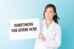 Doctor showing sign with isoretinoin fir severe acne